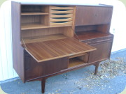 Danish 50's teak                           highboard sideboard buffet with sliding doors,                           drawers, bar cabinet and secretary