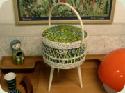 Three legged white                           lacquered rattan sewing basket