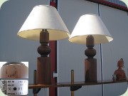 A pair of large                           rosewood stained 70's table lamps made by                           Luxus, Sweden