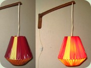 50's or 60's teak wall                           light with plastic ribbon shade