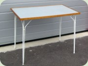 Patio table in white                           lacquered metal and laminated top