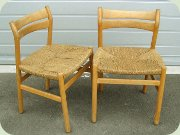 A pair of oak side                           chairs with rope seat, Danish design by Börge                           Mogensen for C.M. Madsens Fabriker 1958