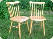 A pair of beech                           kitchen chairs