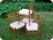 Set of four 60's teak                           or teak stained beech dining chairs made in                           DDR East Germany