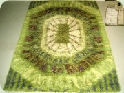 Wool rug by Carnival,                           England