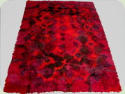Wahlbecks Melodi-rya                           Sonat, Swedish 60's wool rug in red and                           purple