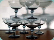 Elegant ball stemmed                           cocktail glasses in bluish grey