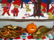 Guldkroken Hjo orange apple lided jar,                           fish shaped vase and shell shaped dish in                           golden lustre glaze