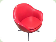 Lounge chair on swivel                           base, red vinyl