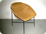 50's or 60's wicker                           chair on black lacquered metal base