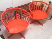 Red, wooden                           swivelchairs, probably by Edsbyverken