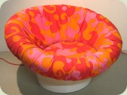 60's Krokus lounge                           chair by Lennart Bender, Ulferts, upholstered                           in orange, red & pink fabric