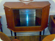 50s bar cabinet with black legs and                           magazine shelf