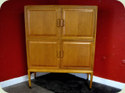 Swedish 50's 4 door                           cabinet with shelves, moulded drawers and                           sculptural handles, made by Bodafors