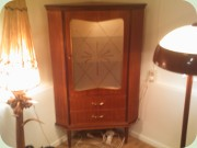 50s Swedish teak corner cabinet with                           glass door and drawers