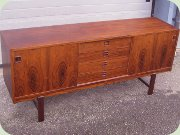 60's rosewood                           sideboard with sliding doors and drawers