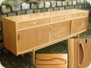 Scandinavian 60's or                           70's light oak long sideboard with 3 drawers                           and sliding doors