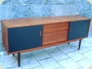 Troeds Trio                           Swedish50's or 60's teak sideboard with 5                           drawers andblack lacquered sliding doors,                           designed byNils Jonsson