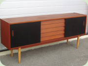 Troeds Trio Swedish                           50's or 60's teak sideboard with 5 drawers and                           black lacquered sliding doors, designed by                           Nils Jonsson