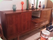 Huge                           sideboard with sliding doors, in the middle 4                           drawers and bar cabinet
