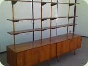 Rosewood cabinets with                           shelves on a brass base, made by Treman /                           Threemen & CFC Silkeborg