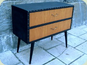 Swedish 50's small                           chest of drawers dressed in black vinyl