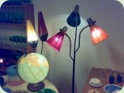50's standard lamps                           with shades in plastic stripes and thread.