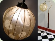 50's tripod floor lamp                           in mahogany tainted wood, brass and black                           lacquered metal with a round shade dressed in                           plastic
