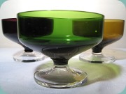 4 dessert bowls in                           purple, green and amber with leg in clear                           glass