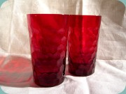 Red tumblers with                           honeycomb pattern by Reijmyre, Sweden
