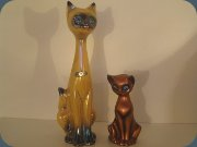 Cat in luster glaze by                           Jema Ware, Holland and Cortendorf cat in                           copper glaze